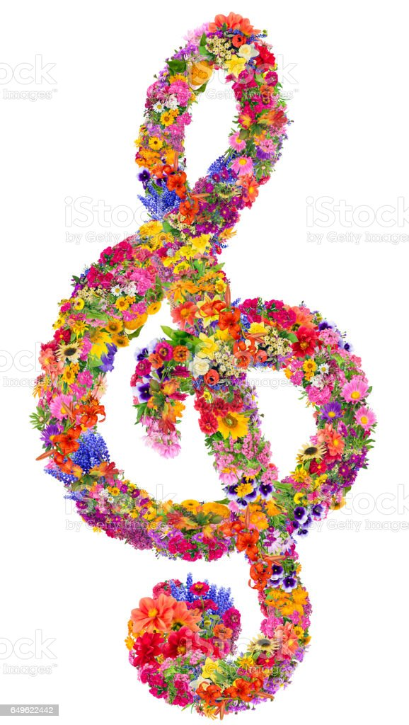 Abstract sign of a musical treble clef made from flowers. Isolated handmade spring collage stock photo