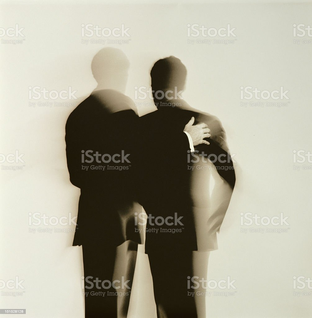 Abstract silhouette back view of two businessmen stock photo