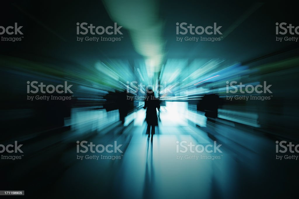 Abstract Silhouettes of People in Blue Corridor, Blurred Motion stock photo
