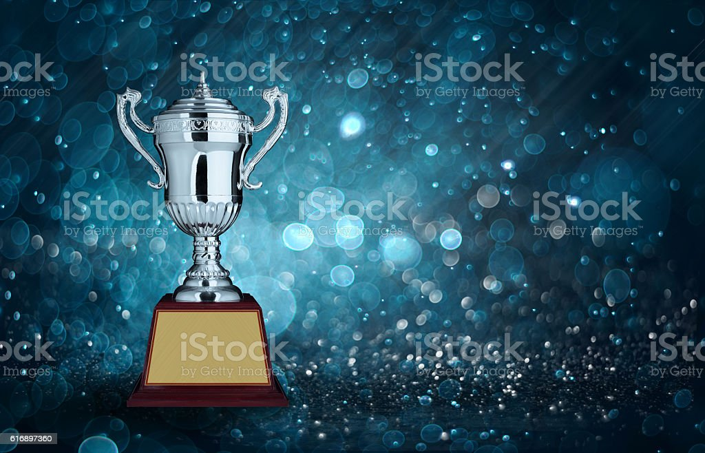 abstract silver trophies with blue bokeh lighting. copy space re stock photo