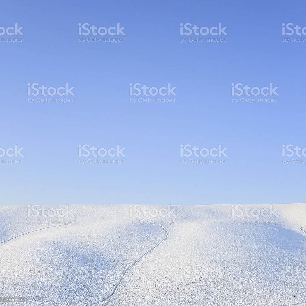 Abstract snow rolling hills landscape in winter. Tuscany, Italy stock photo