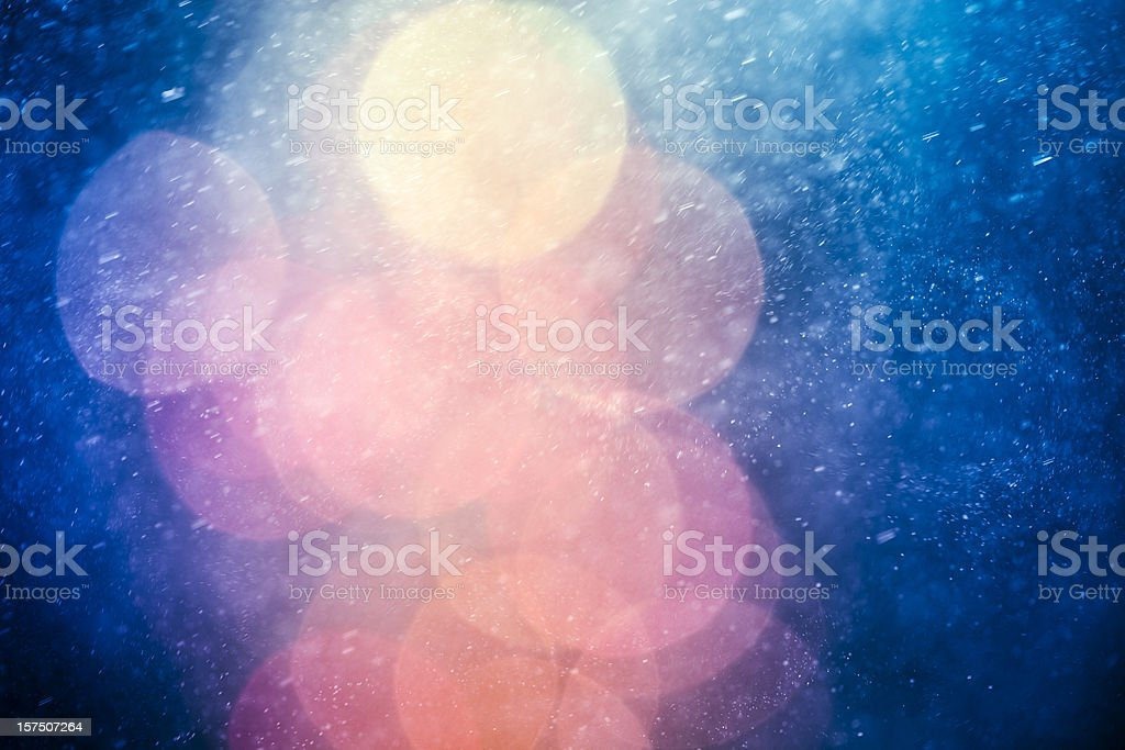 Abstract snowstorm with defocused lights stock photo