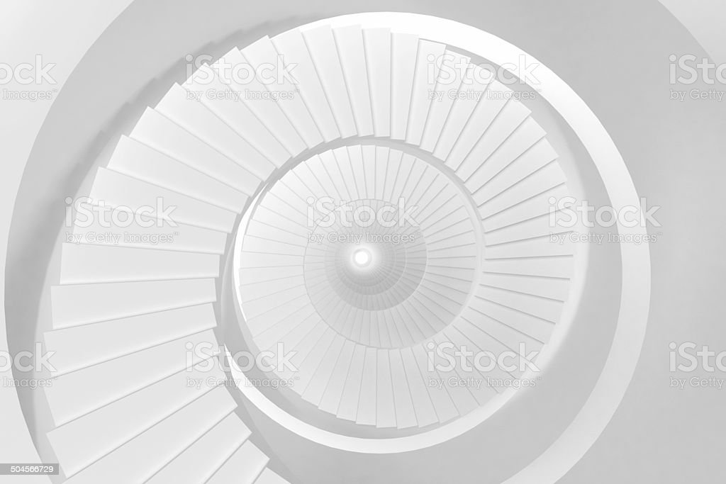 Abstract spiral staircase, empty space, bright white concentric tunnel stock photo