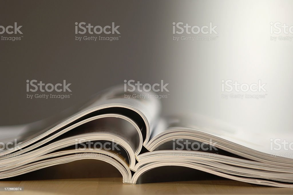 Abstract Stack of Open Magazines stock photo