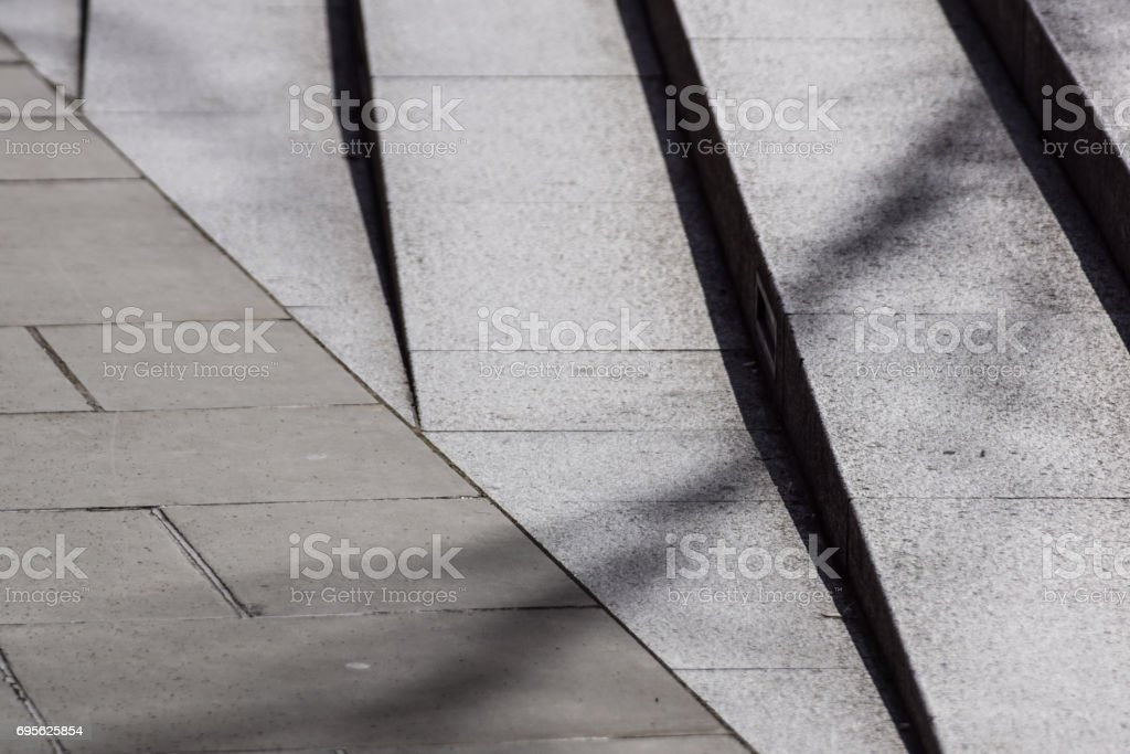 Abstract stairs , abstract steps, stairs in the city, granite stairs,wIde stone stairway often seen on monuments and landmarks,wide stone stairs, steps,black and white photo,diagonal stock photo