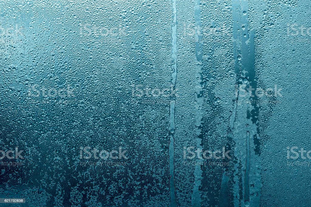 abstract texture of wet glass blue green color stock photo
