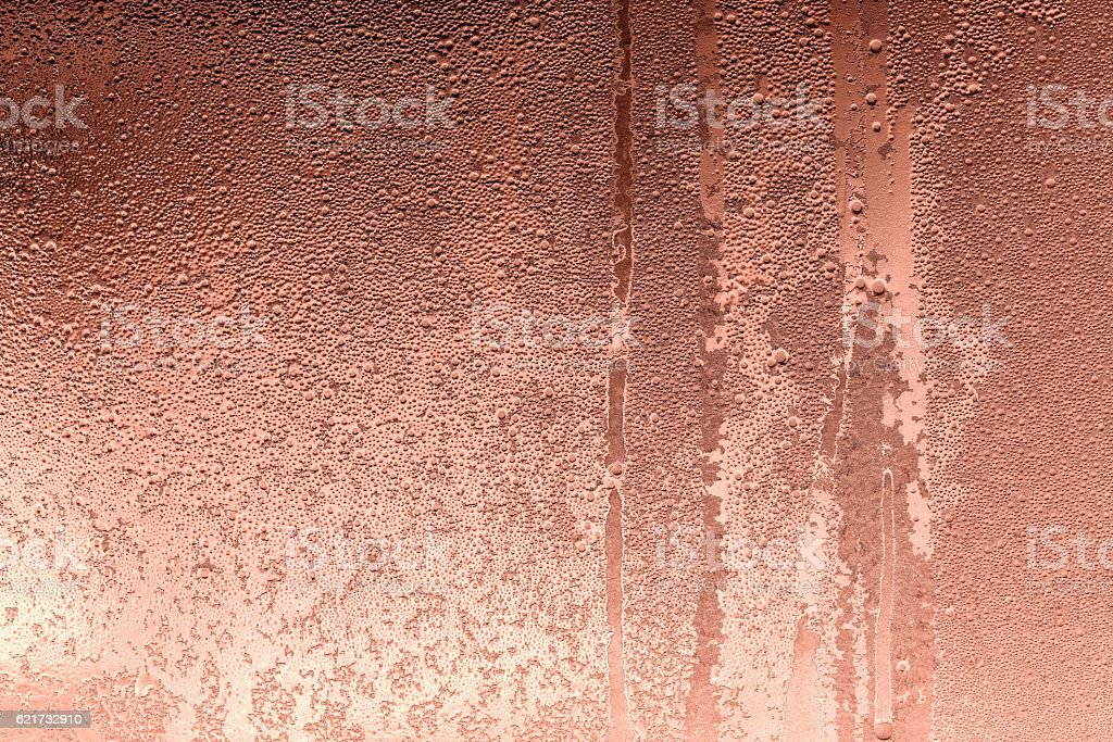 abstract texture of wet glass copper color stock photo