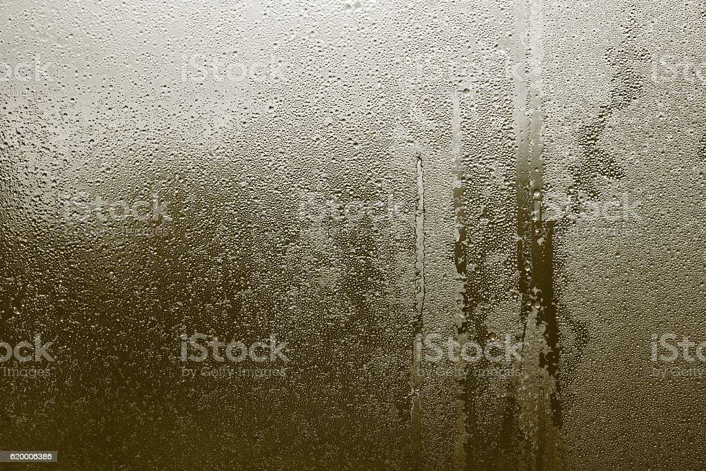 abstract texture of wet glass khaki color stock photo