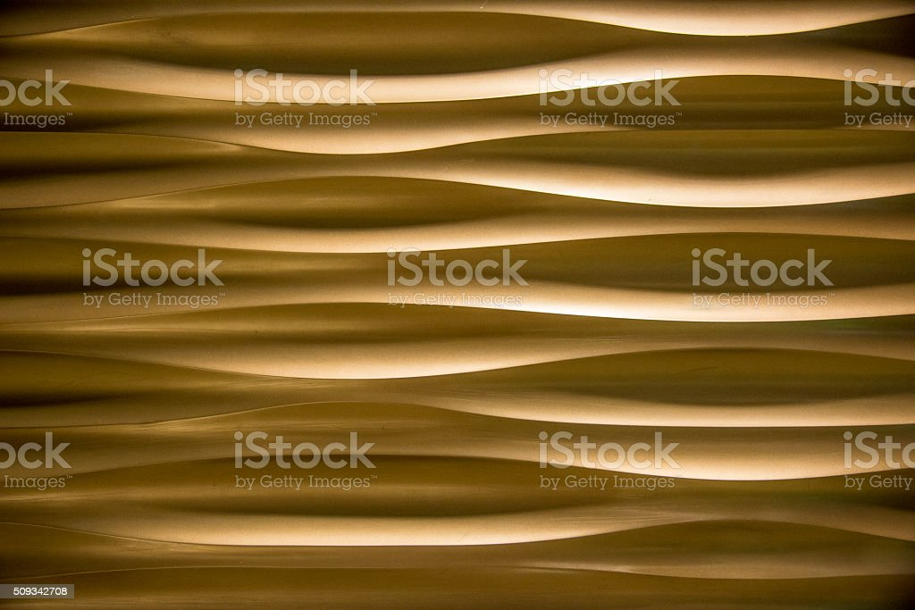 Gold texture in a shape of sand dunes.