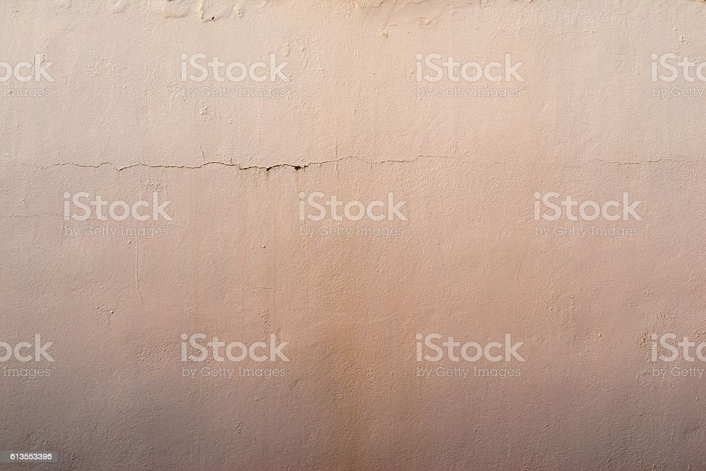 abstract textured apricot background of the old plastered surface stock photo