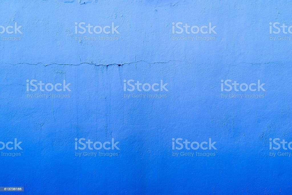 abstract textured blue background of the old plastered surface stock photo