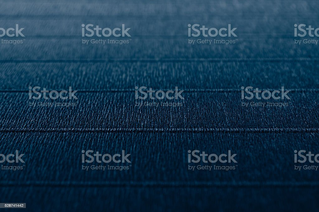 Abstract textured  minimalist deep blue background with horizontal lines. stock photo