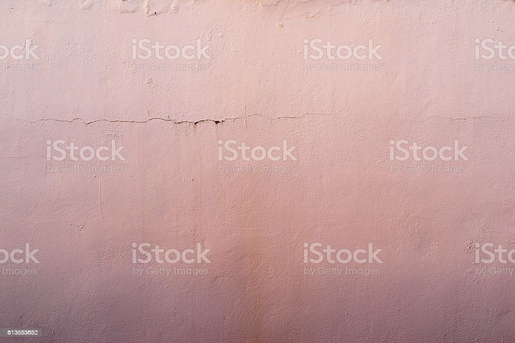 abstract textured pink background of the old plastered surface stock photo