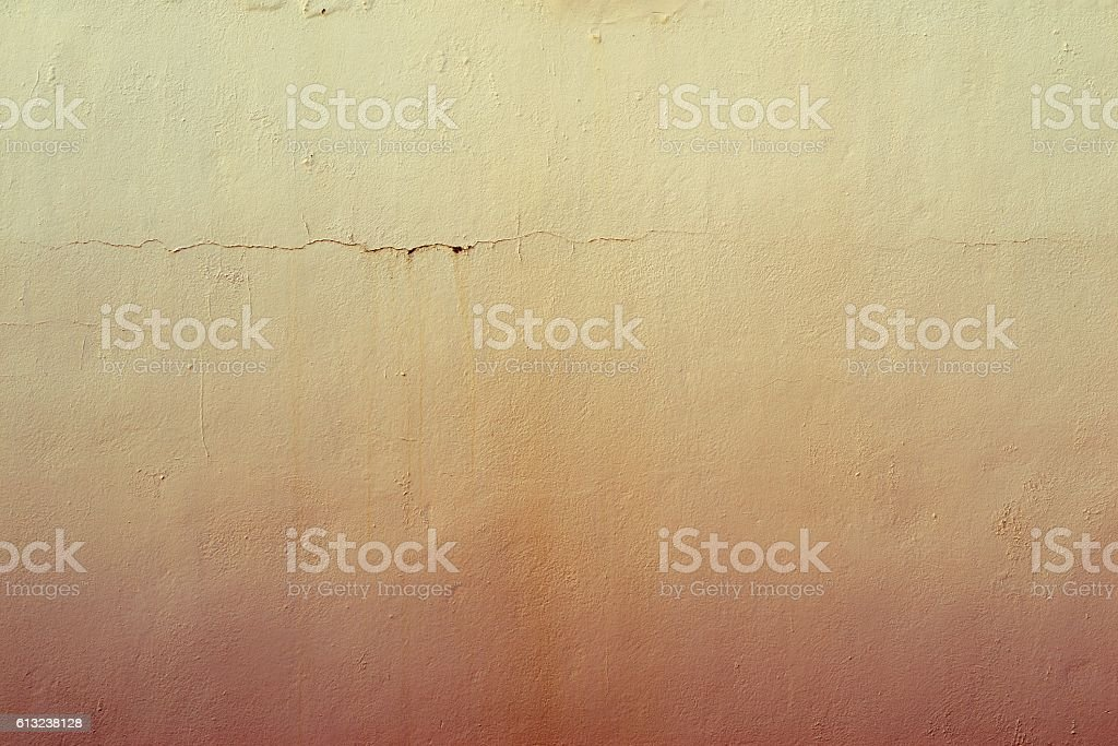 abstract textured yellow background of the old plastered surface stock photo