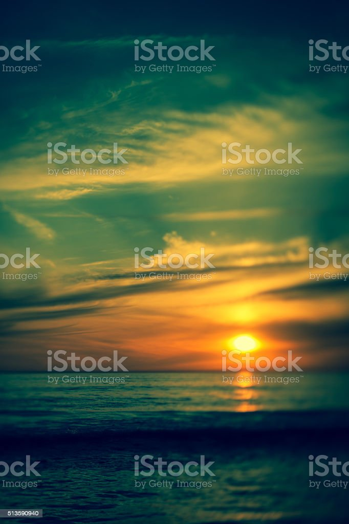 Abstract toned image of ocean and sunset stock photo