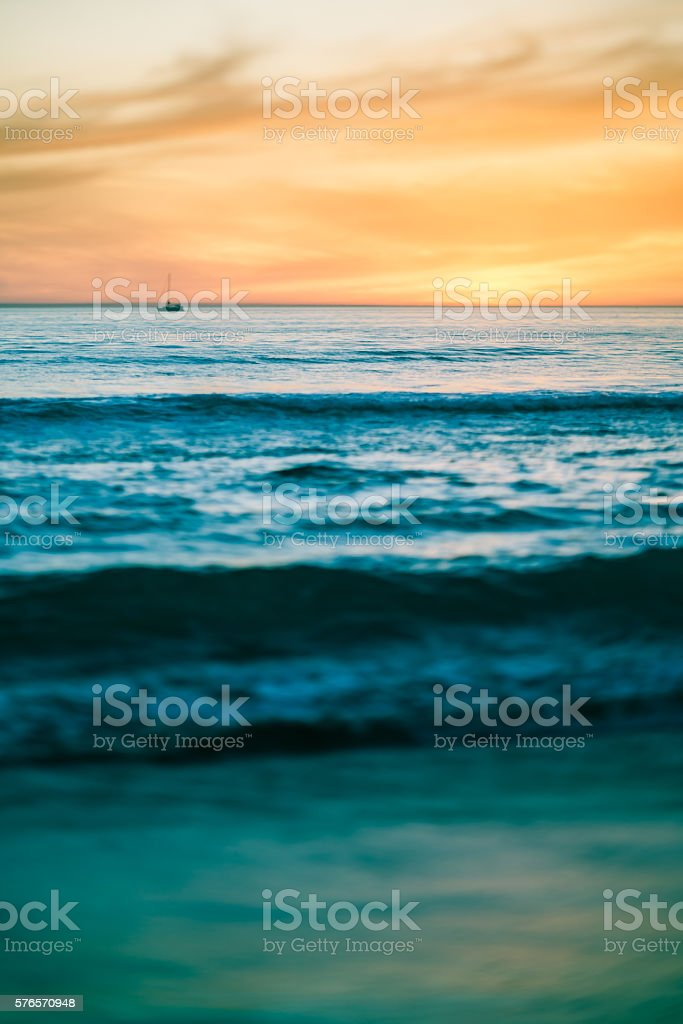 Abstract toned image of ocean scene at sunset stock photo