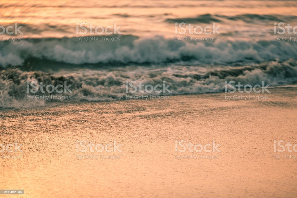 Abstract toned image of sun reflection on beach stock photo