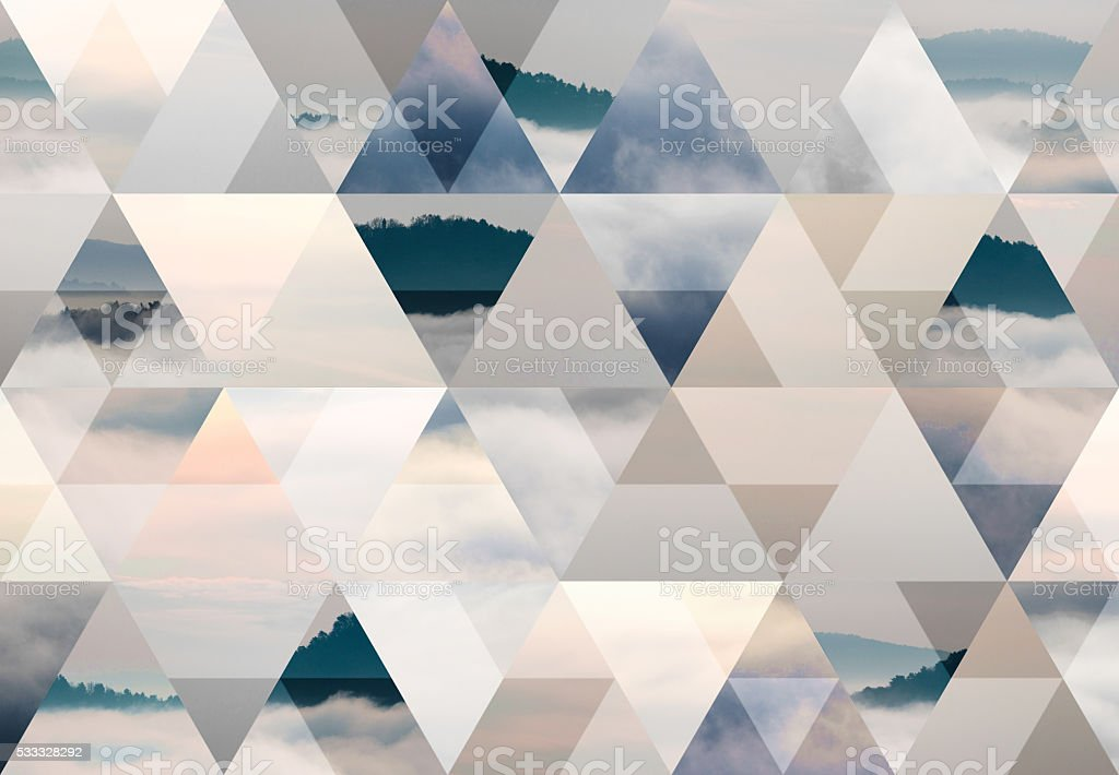 Abstract triangle shaped background: Hill in a sea of fog stock photo
