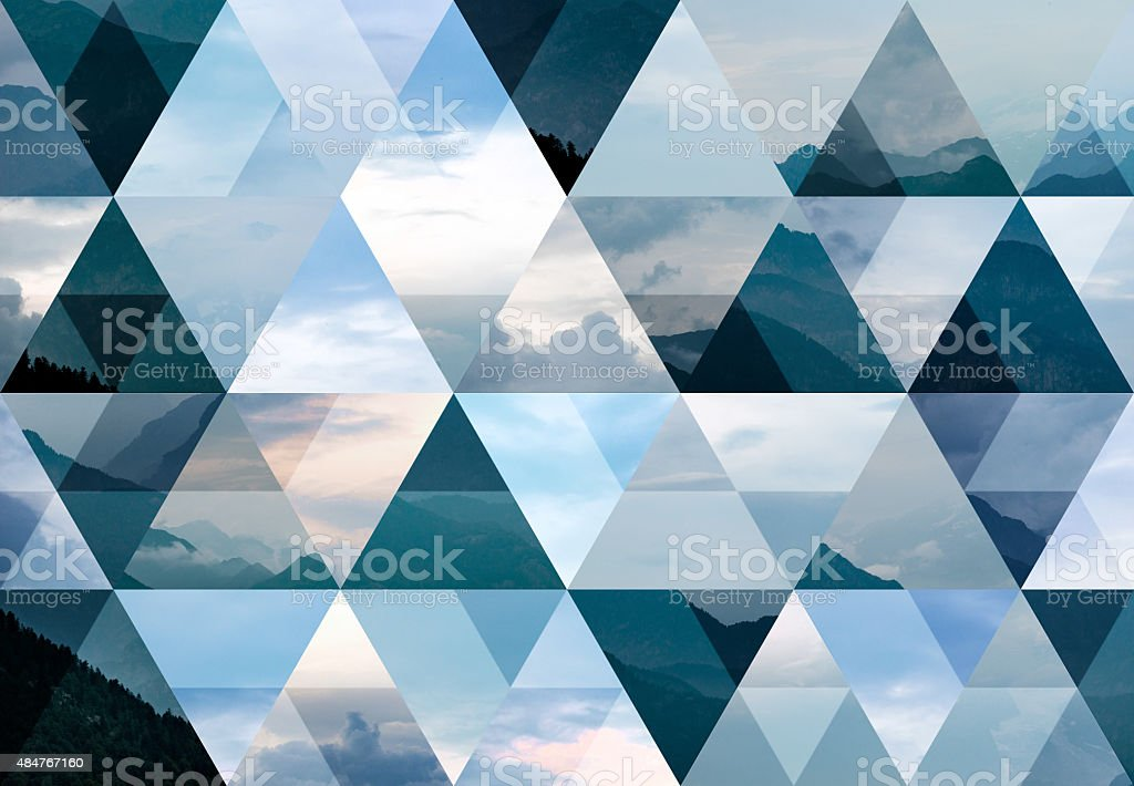 Abstract triangle shaped background: Italian Alps mountains misty landscape stock photo