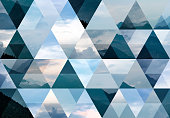 Abstract triangle shaped background: Italian Alps mountains misty landscape