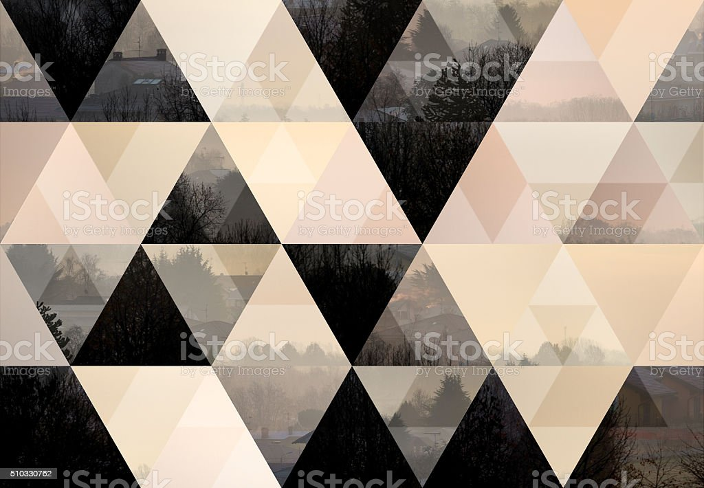 Abstract triangle shaped background: Italian mountain town autumn misty landscape stock photo