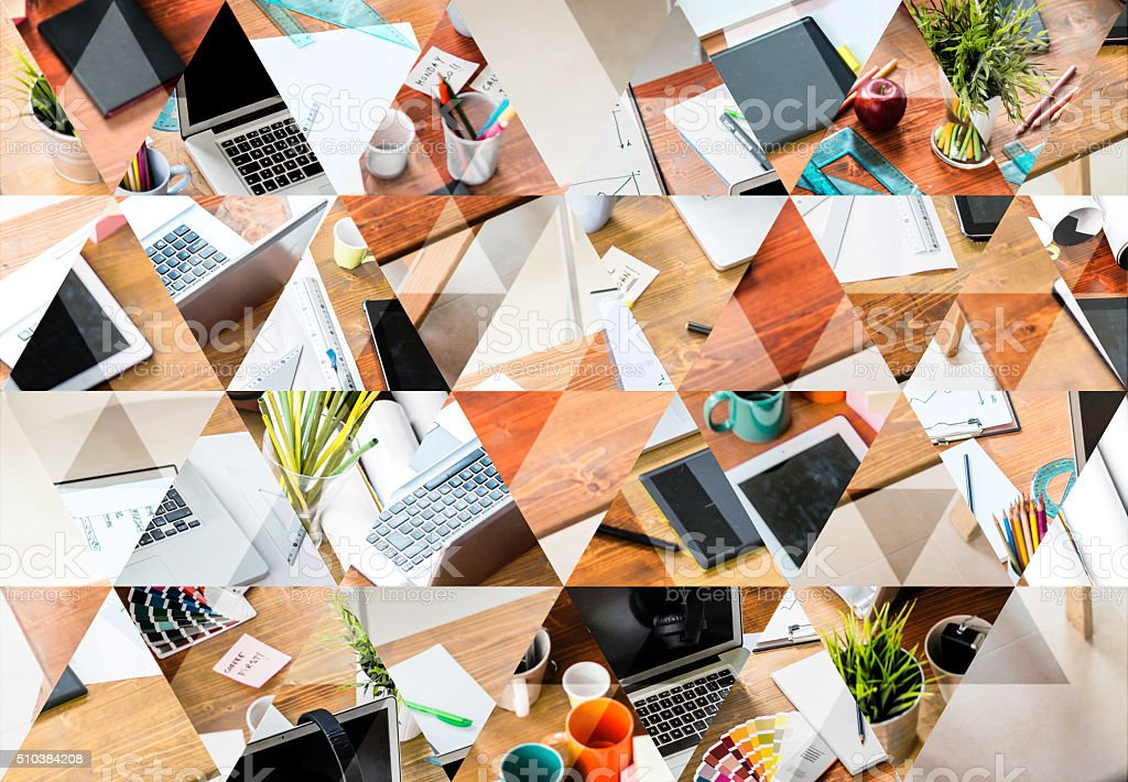 Abstract triangle shaped background: Messy desk of young startup stock photo