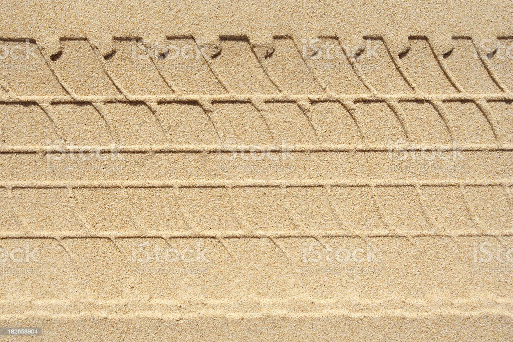 abstract tyre print in sand royalty-free stock photo