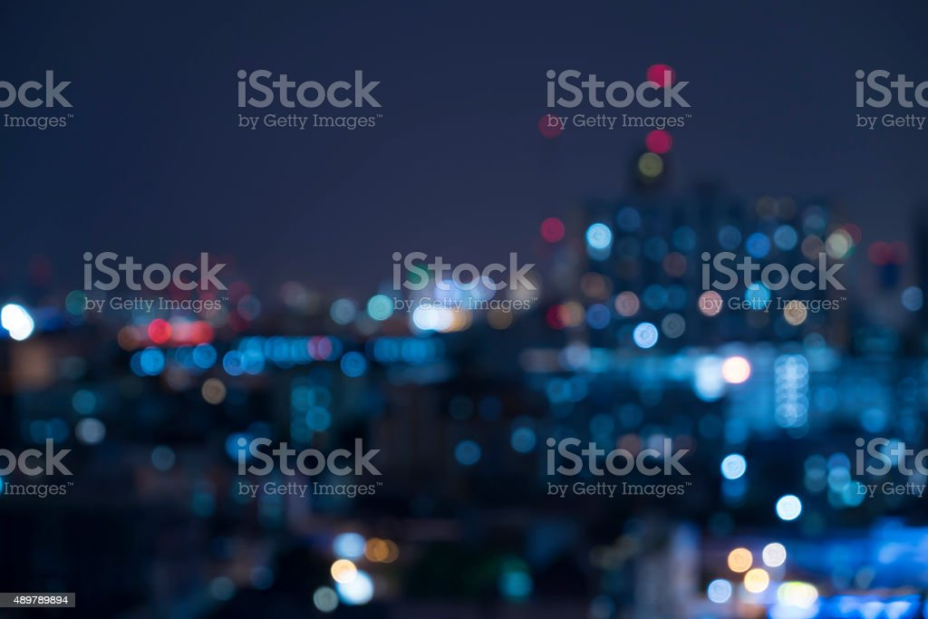 Abstract urban night light bokeh , defocused background stock photo
