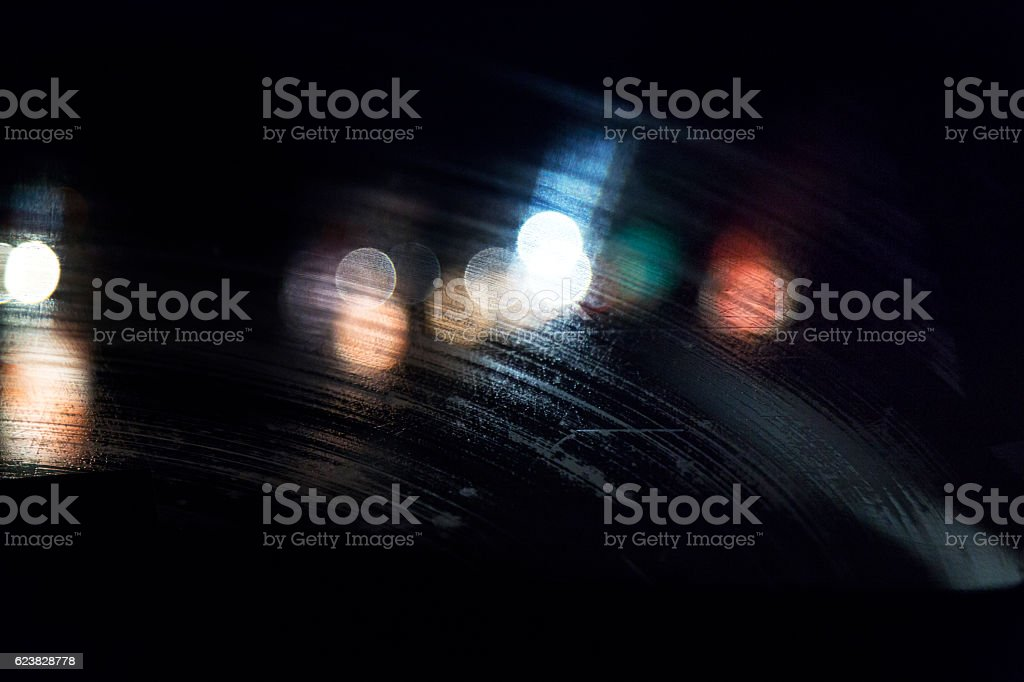 Abstract Vehicle Lights Through Streaky Rain Water Night Car Windshield stock photo