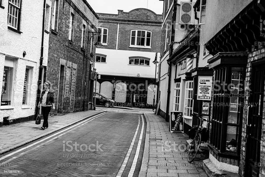 Abstract view of a solitary shopper in a market town stock photo