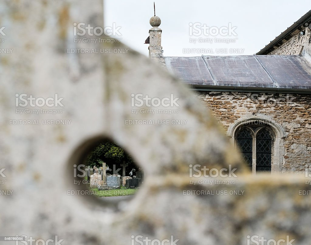 Abstract view of a stone cross at a churchyard stock photo