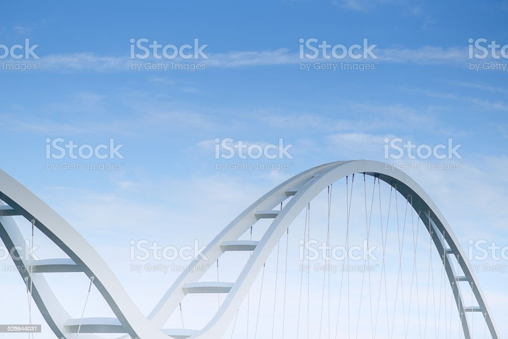 Abstract view of bridge support against a blue sky. stock photo