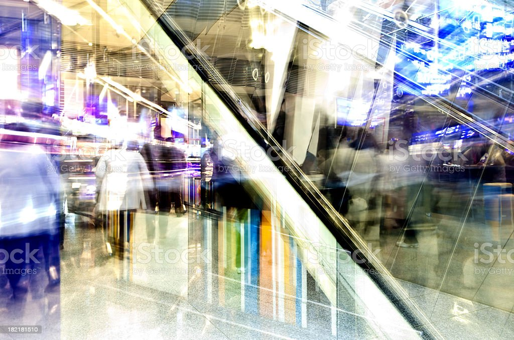 Abstract View of Interior with Escalator and Blurred People royalty-free stock photo
