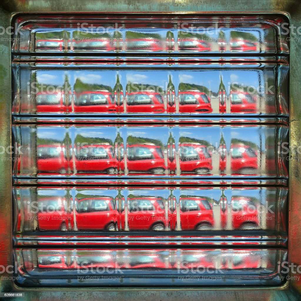 Abstract View of Red Car through a Square Glass Brick stock photo