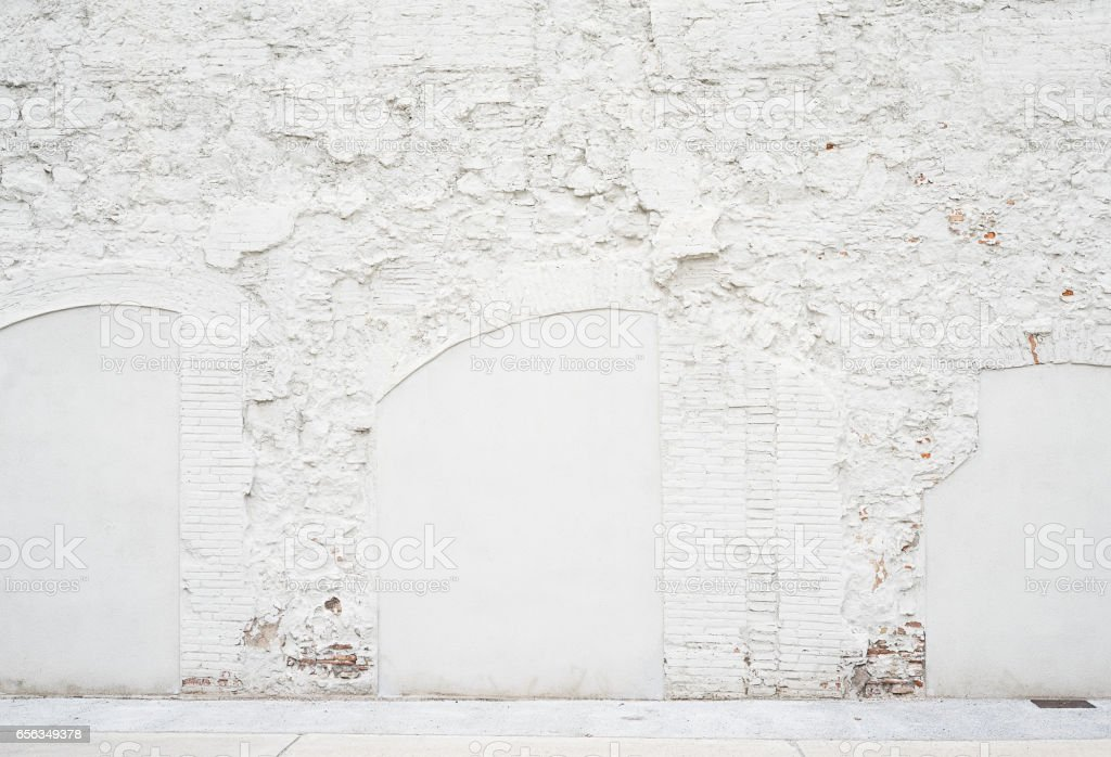 Abstract vintage empty background.Photo of grungy white painted brick wall texture. White washed brickwall surface.Horizontal mockup. Front side view. stock photo