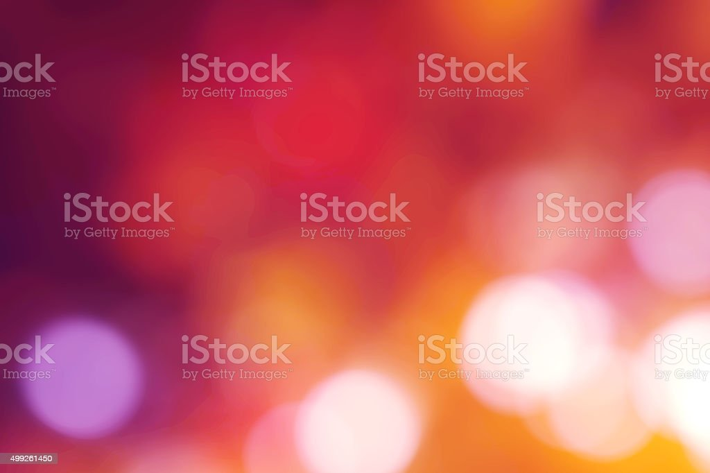 Abstract violet, pink, yellow and orange bokeh background stock photo