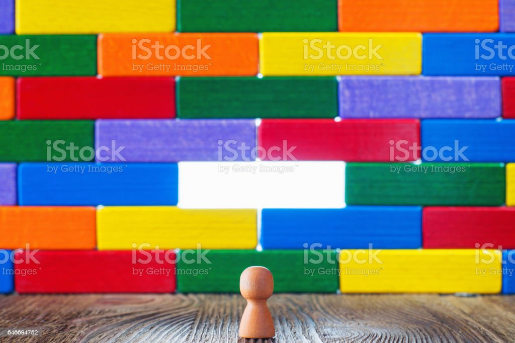 Abstract wall or barrier of multicolored wooden blocks stock photo