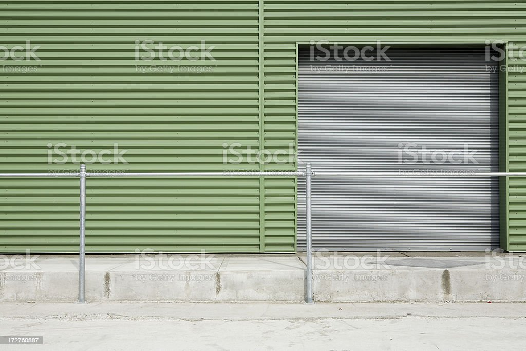 Abstract warehouse wall exterior; colored paneling and background texture backdrop stock photo