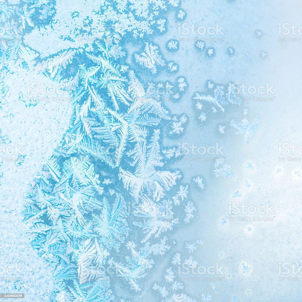 abstract winter ice texture on window, festive background stock photo