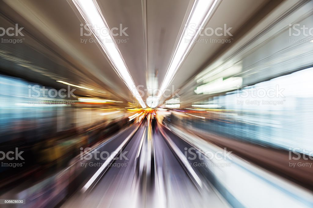 abstract zoom picture of a moving walkway at the airport stock photo