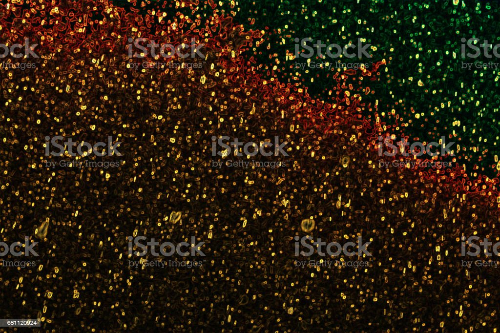 Abstraction, burning sparks of fire, dots of gold and red stock photo