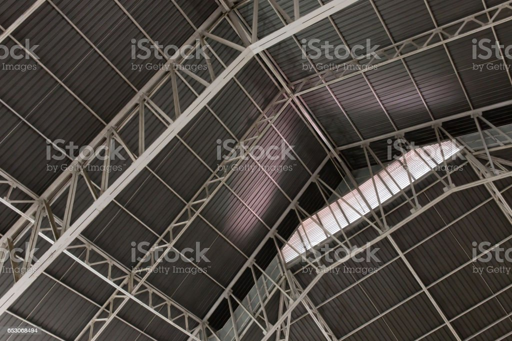 Abstract.metal framework of the roof of industrial premises in the enterprise inside view in black and white stock photo