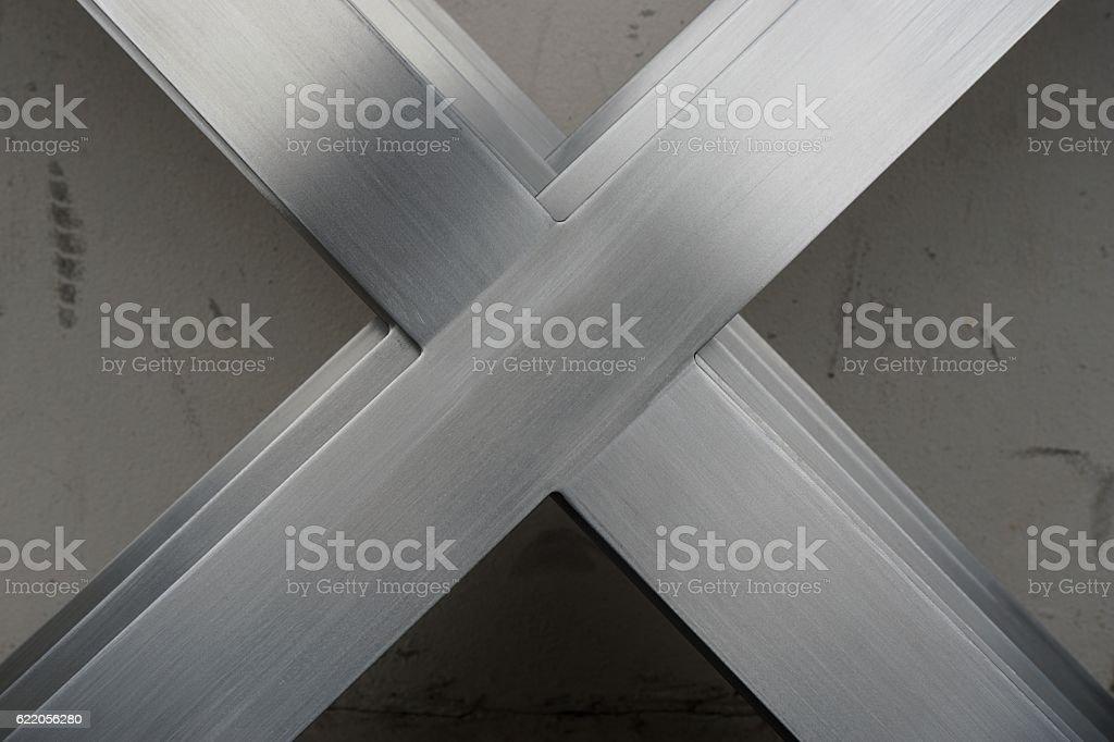 abtract metal x shape stock photo