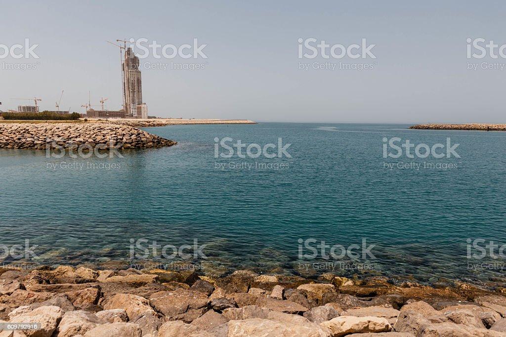 Abu Dhabi Rock Coast with Building and the Sea, UAE stock photo
