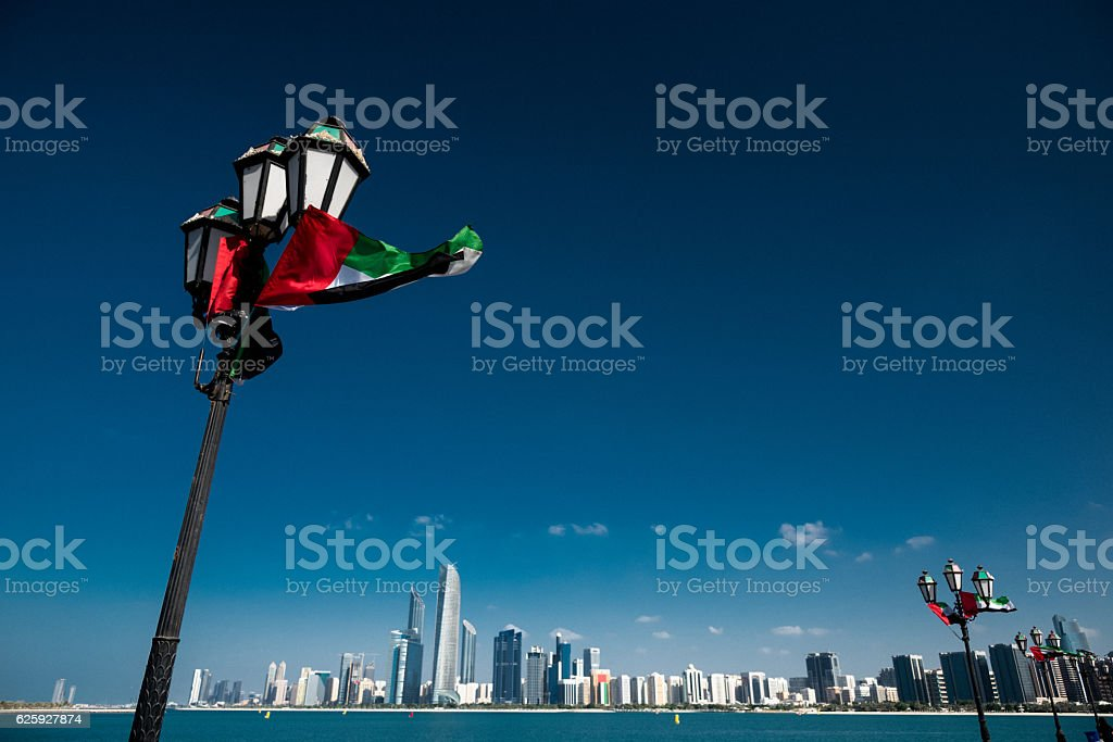 Abu dhabi skyline with national flag stock photo