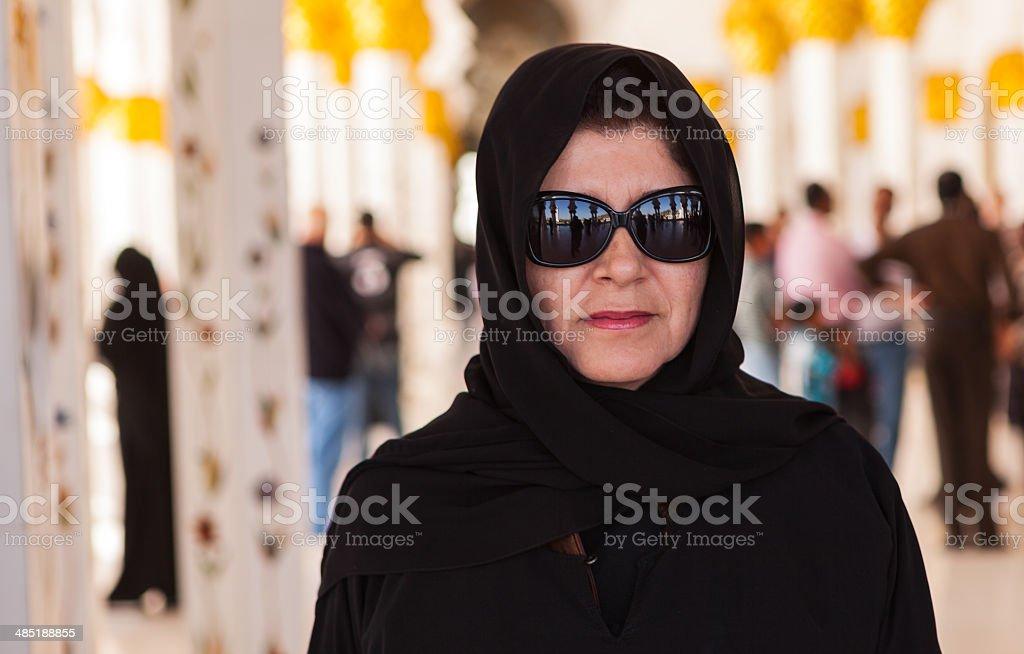 Abu Dhabi, UAE; Tourist at Sheikh Zayed Grand Mosque royalty-free stock photo
