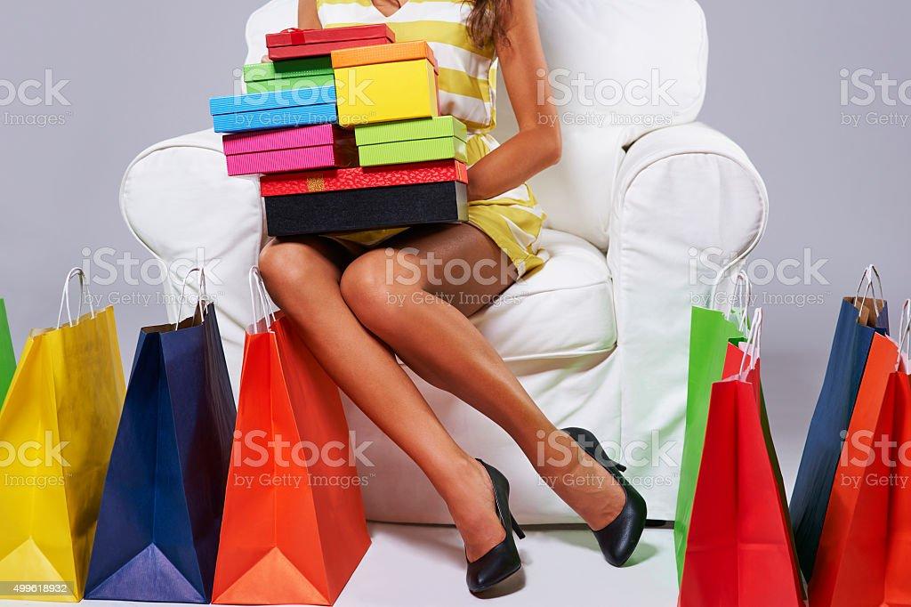 Abundance of shopping bags around the woman stock photo