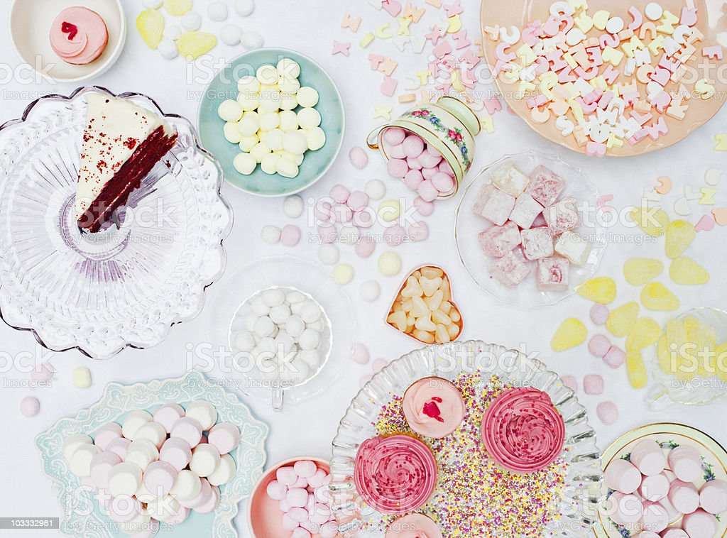 Abundant variety of vibrant sweets in dishes on table stock photo