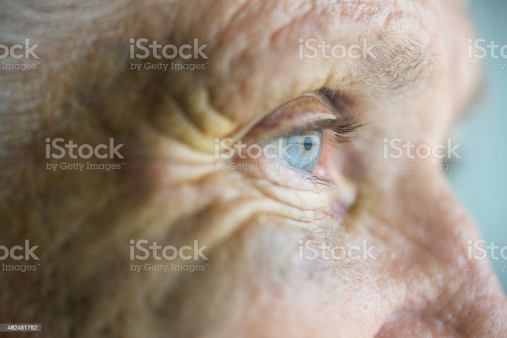 Abused caucasian senior woman with black eye stock photo