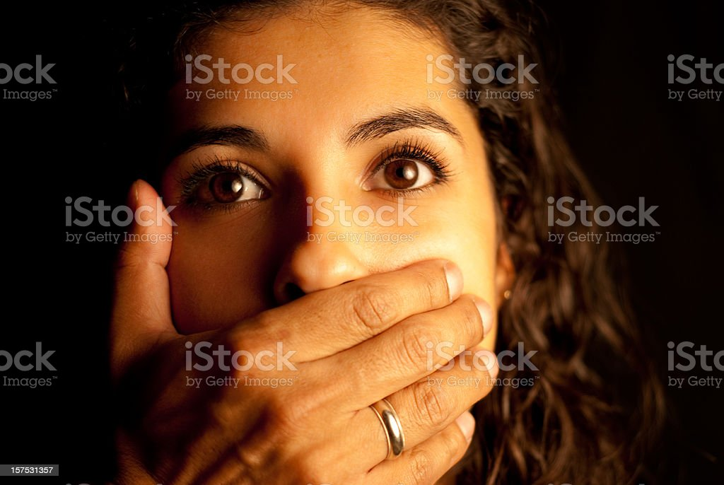Abused Woman being silenced stock photo